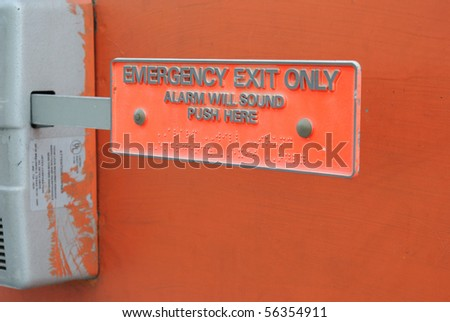 Emergency exit with braille and text on the push lever. - stock photo
