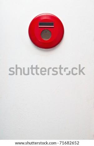 Emergency fire alarm isolated on white - stock photo