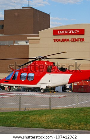 Emergency medical helicopter sitting outside a trauma center. - stock photo