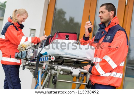 Emergency paramedics radio call ambulance house door visit doctor - stock photo