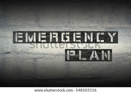 emergency plan stencil print on the grunge white brick wall