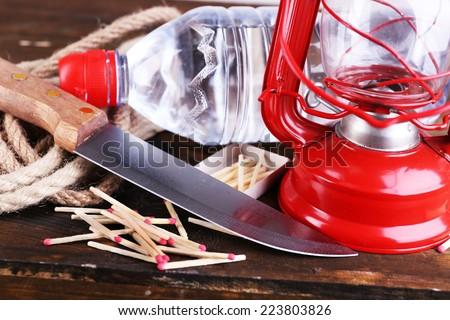 Emergency preparation equipment on wooden background - stock photo