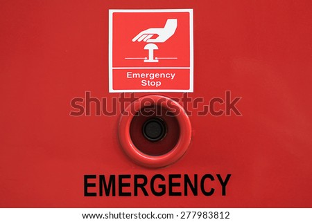 emergency stop button with sign - stock photo