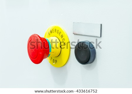 Emergency stop buttons must be obvious to see and simple to operate - stock photo