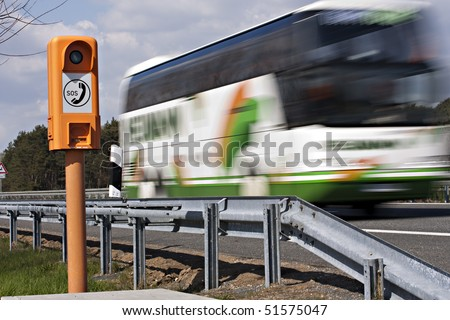 emergency telephone at highway and driving coach - stock photo