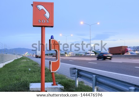 emergency telephone on highway in the evening time