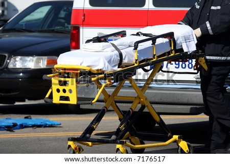 Emergency worker moving stretcher - stock photo