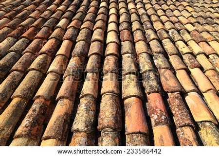 Emerging lines of traditional ceramic roof tiles on a building in Dubrovnik, Croatia - stock photo