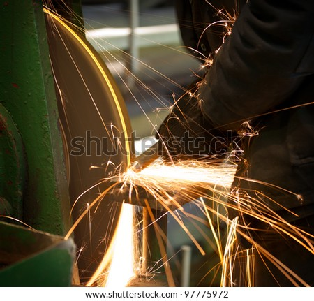 Emery in process in machinery workshop - stock photo