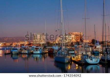 Emeryville, CA panorama at night. The beautiful harbor with the Berkeley Hills in the background - stock photo