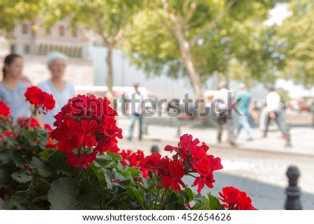 Eminonu square in Istanbul...Intentionally out of focused people walk and shop in this crowded district of the city.  - stock photo