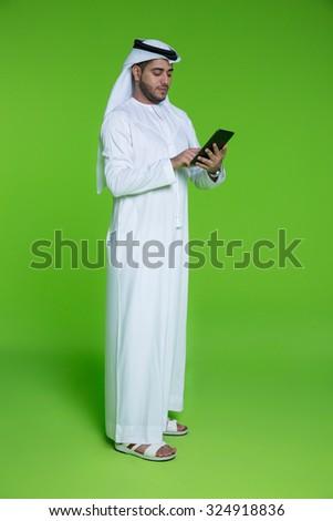 Emirati businessman using digital tablet - stock photo