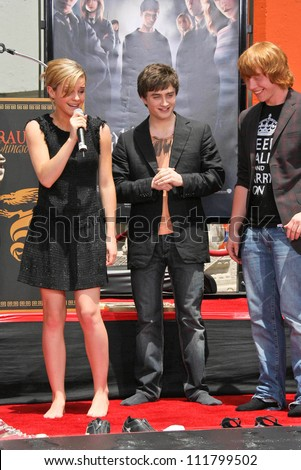 """Emma Watson with Daniel Radcliffe and Rupert Grint at the Hand, Foot and Wand Print Ceremony Honoring The Cast of """"Harry Potter"""". Grauman's Chinese Theater, Hollywood, CA. 07-09-07 - stock photo"""