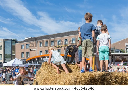 EMMELOORD, THE NETHERLANDS - SEP 10: Kids playing at hay bales on an agricultural potato festival on September 10, 2016 in Emmeloord, captial city of Noordoostpolder, the Netherlands