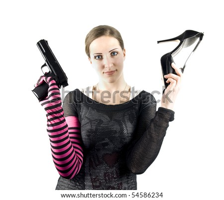 EMO girl with gun and shoe - stock photo