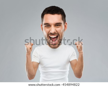 emotion, success, gesture and people concept - young man celebrating victory and screaming over gray background  (funny cartoon style character with big head) - stock photo
