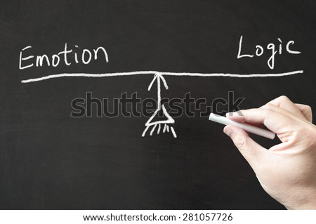 Emotion vs logic words and sign written on the blackboard using chalk