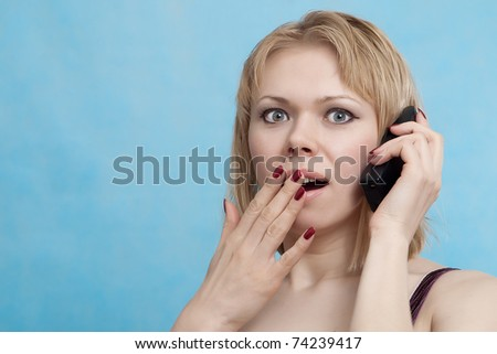 Emotion Woman  talking on a mobile on a blue background - stock photo