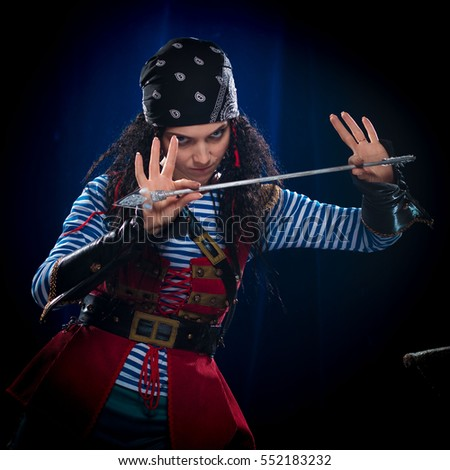 emotional actress woman in a pirate costume on a blue-black background