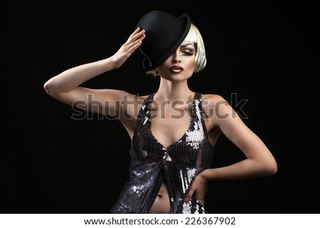 emotional and bright woman with beautiful make-up and hat in hand - stock photo