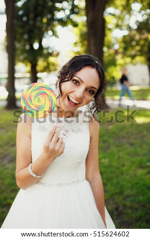 Emotional and joyful bride with the colorful lollipop