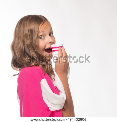 Emotional blonde girl in a pink jacket on a white background