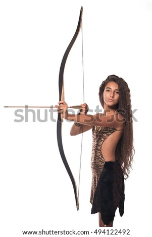 Emotional brunette girl with long hair in the Amazon costume with bow and arrow on a white background.