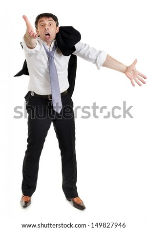 Emotional businessman with his suit jacket slung over his shoulder pleading his cause gesticulating with both hands, full length portrait isolated on white