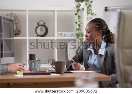 Emotional businesswoman gesturing during meeting at office - stock photo