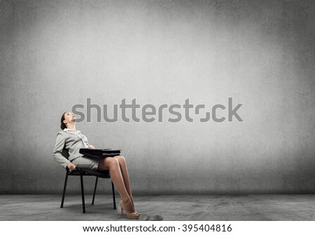 Emotional businesswoman in chair