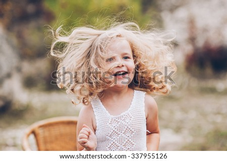 emotional child girl outdoors - stock photo
