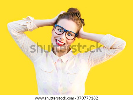 Emotional colorful summer autumn outdoor funny pretty girl with fun sunglasses red lips and comic stress excited surprised scream smile laugh tongue out yellow isolate background - stock photo