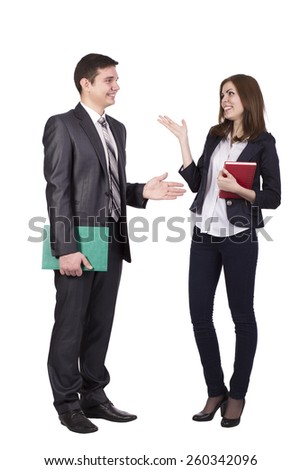 Emotional conversation. Young male and female, officially dressed, discussing and hand gesturing. - stock photo