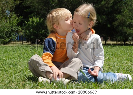 Emotional couple on a glade in park - stock photo