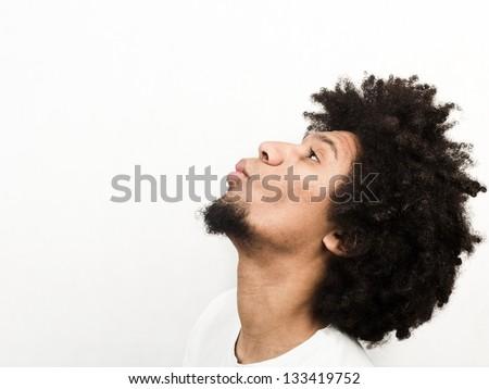 Emotional facial expression of man - kiss - stock photo
