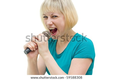 Emotional girl with a microphone in his hands - stock photo