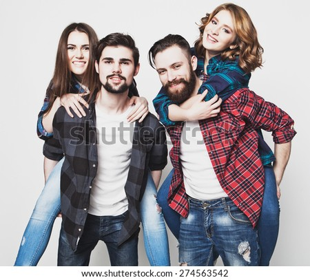 emotional, happiness and people concept: Group Of Young People Giving Piggybacks over white background.Special Fashionable toning photos. - stock photo