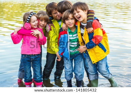 Emotional kids enjoying their time in fall - stock photo