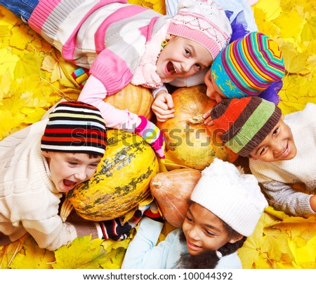 Emotional kids on yellow autumnal leaves