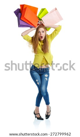 Emotional lovely woman with shopping bags over white background - stock photo