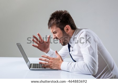 emotional man and laptop