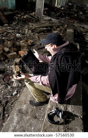 emotional man with laptop - stock photo