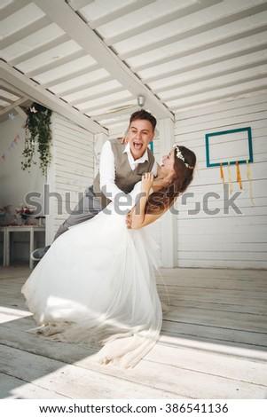 Emotional Moment of Wedding Dance. Beautiful Newlywed Couple. - stock photo