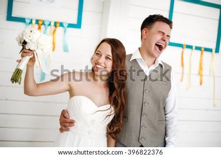 Emotional Moment of Wedding Day. Beautiful Newlywed Couple. Selective Focus. - stock photo
