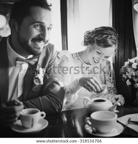 Emotional newlywed couple in cafe having fun together. Wedding.