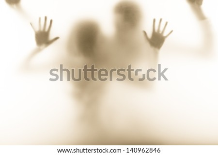 emotional picture of man and woman standing behind the milk glass - stock photo