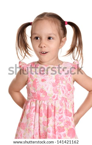 emotional portrait of a little girl in a pink dress