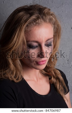 emotional portrait of a young  crying  girl - stock photo