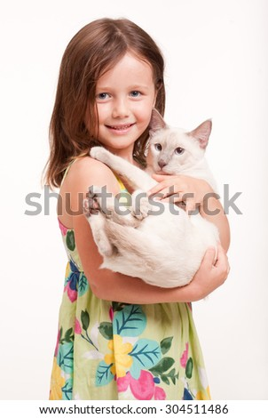 Emotional portrait of a young girl with her cat. - stock photo