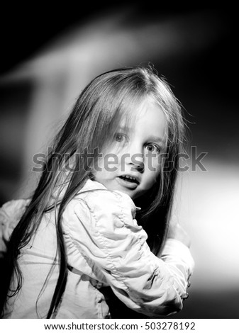 Emotional portrait of cute little girl in vintage style